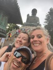 Parents next to big buddha